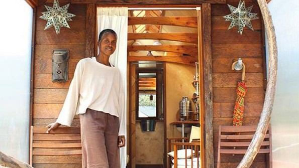 Dominique Moody by the door to her tiny house