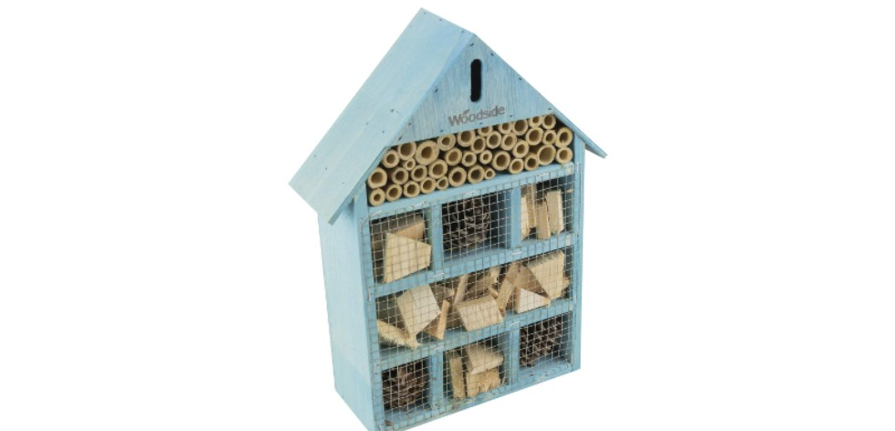 Blue painted bee hotel