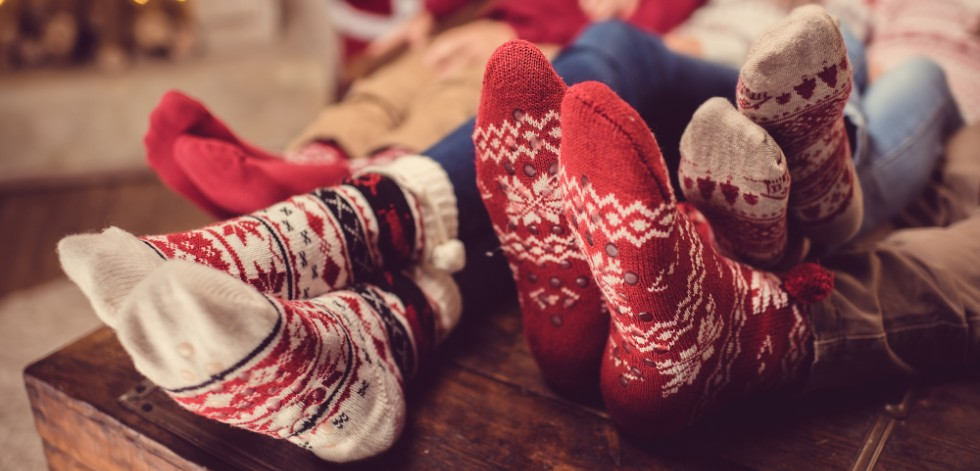 A family's feet in chunky red and white winter socks