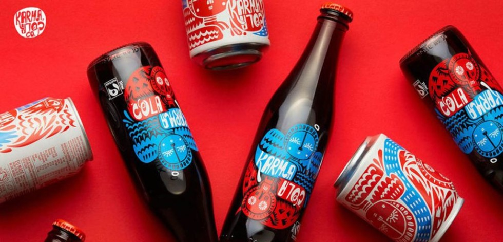 Karma Cola bottles and cans on a red background