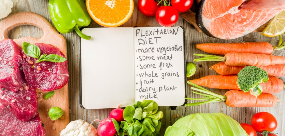 A list of flexitarian diet foods on a table surrounded by different foods