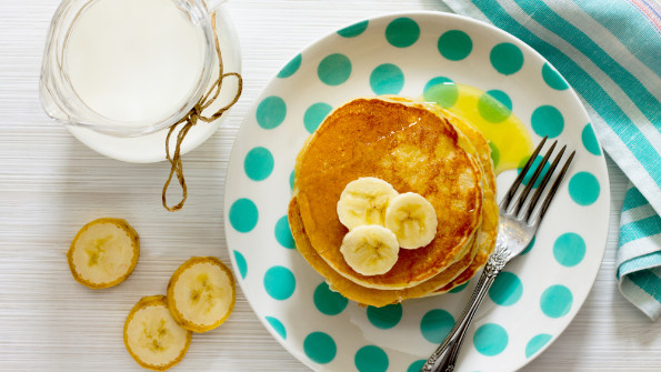 Pancakes with bananas and a jug of milk