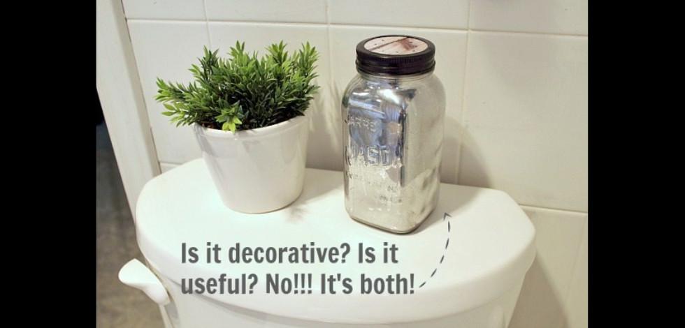 Mason jar air freshener sitting on a toilet cistern