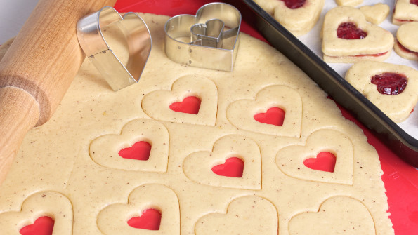 Rolled out pastry with heart cutters