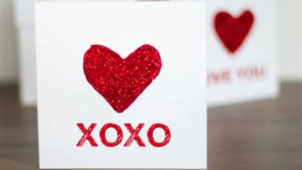 Homemade Valentine's card with glittery red heart on the front
