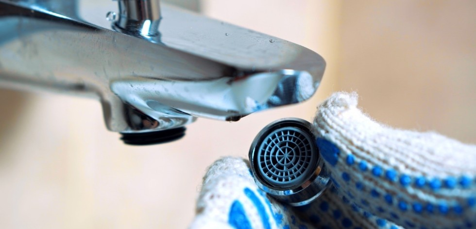 a tap aerator being fitted